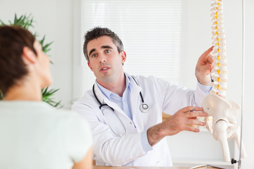 doctor explaining the spine to a patient